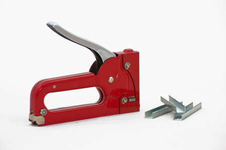 staple gun: Staple gun with staples. Stock Photo