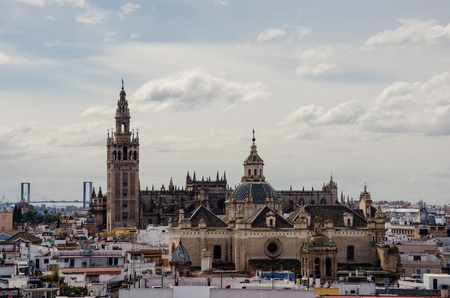 The Cathedral of Seville also known as Cathedral of Saint Mary of the See, with its famous La Giralda bell tower, built on a moorish minaret. It's the largest cathedral in the world
