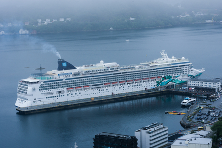 Ã…lesund, Norway - August 7 2018: Cruise ship docked in Ã…lesund, with the engines running