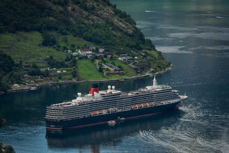 Geiranger, Norway - August 7 2018: Cruise ship leaving the Geiranger fjord Editorial