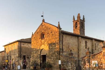 Monteriggioni, Italy - September 30 2018: Church of Santa Maria, at sunset