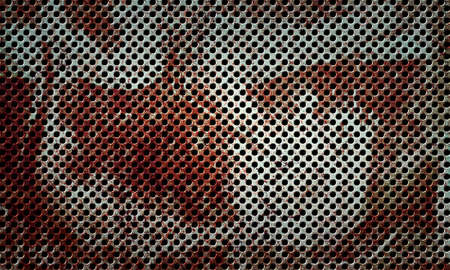 Rusty stainless metal perforated surface with round holes arranged in a row. Grunge background.