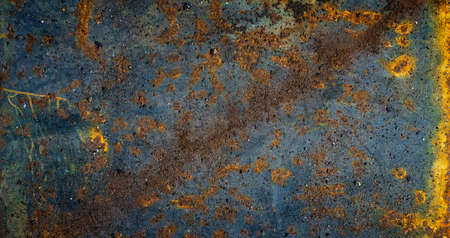 Aged metal plate. Industrial texture. Dark rusty backround with yellow corrosion traces.