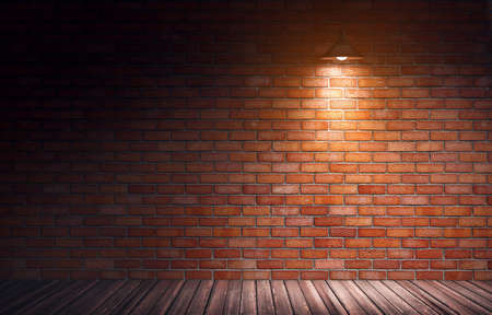 3d rendering illustration of empty old grungy room with red brick wall and wooden floor. Yellow directional light from hanging metal lamp. Industrial building interior.