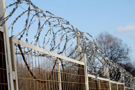 A barbed wire on a fence in the street