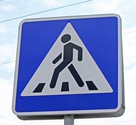 A pedestrian crossing sign in the street photo
