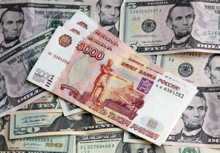 upvaluation: Photo of two currencies - US Dollar and rouble