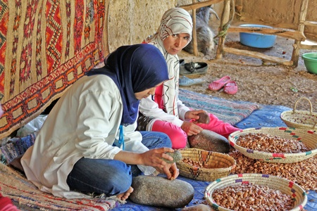 May 28, 2012  Women work in a cooperative for the manufacturing of argan fruits Stock Photo - 15080113
