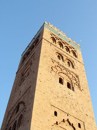 Mosque and a half moon above  Koutoubia mosque in Marrakesh, Morocco Stock Photo - 15133474
