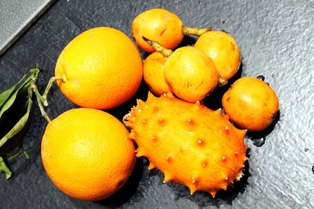 hedged: Exotic fruits  orange, kiwano and loquat