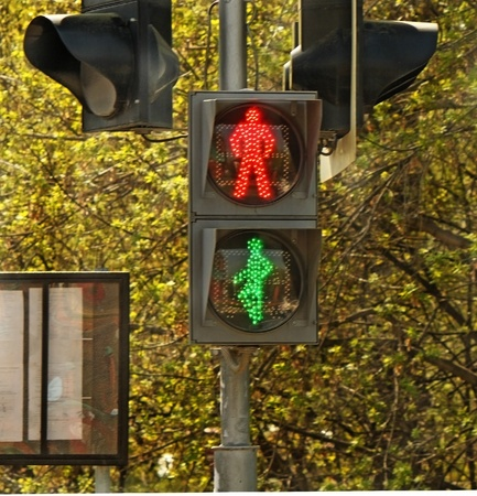 Pedestrian traffic light with red and green lights photo