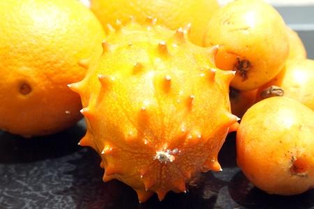 nack: Exotic fruits  orange, kiwano and loquat