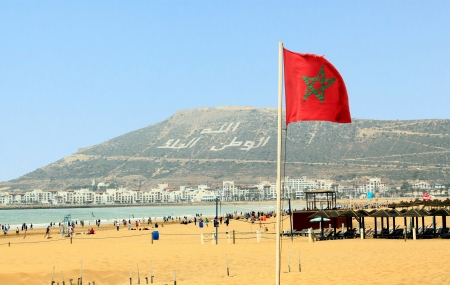 The beautiful beach in Agadir with flag of Morocco  Stock Photo