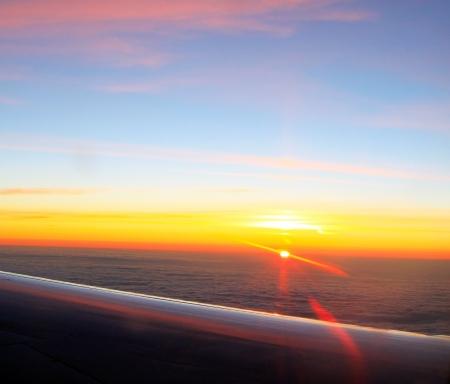 Beautiful aerial sunrise, view from airplane window Stock Photo