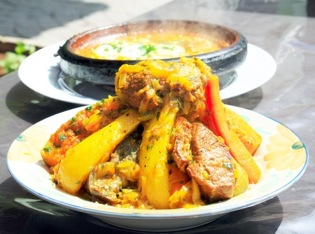Two tajines  moroccan national dishes  of meet with eggs and vegetables