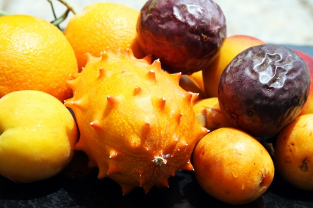 hedged: Exotic fruits  orange, kiwano, loquat, peach and passionfruit