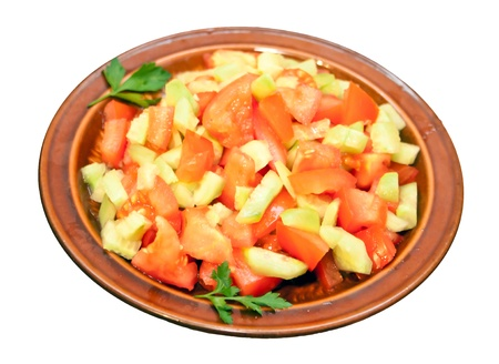 Salad of tomatoes and cucumbers, isolated on white background photo
