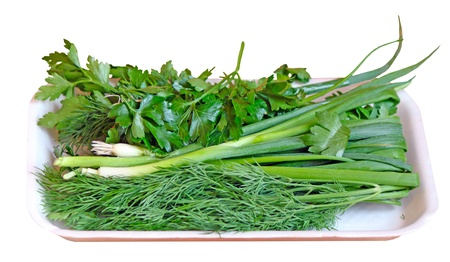 Greens (parsley, onion, fennel) in the retail tray - isolated on white background photo