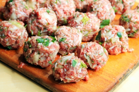 Raw meatballs on the chopping board Stock Photo