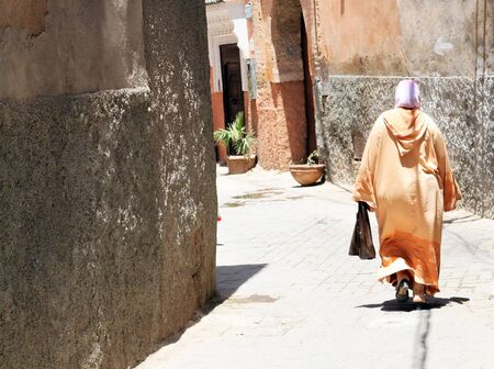 Arabian woman in the street of Marrakesh, Morocco photo