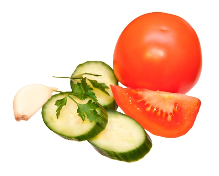Tomatoes and cucumbers with greens, isolated on white background photo