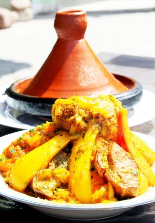 Two tajines (moroccan national dishes) of meet with eggs and vegetables