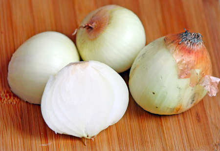 Whole and cut onion on the chopping board Stock Photo - 18538672