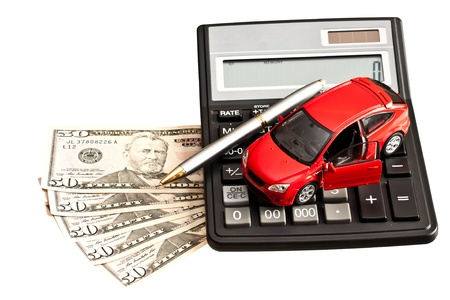 Toy car, money and calculator over white. Concept for buying, renting, insurance, fuel, service and repair costs Stock Photo - 18684875