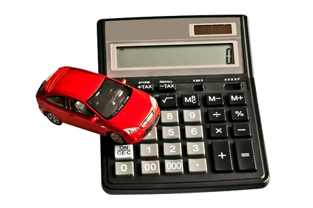 Toy car and calculator. Concept for buying, renting,  fuel, service and repair cost photo