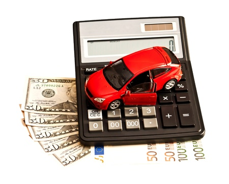 Toy car, money and calculator over white  Concept for buying, renting, insurance, fuel, service and repair costs Stock Photo - 19113907