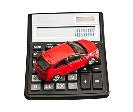Car and calculator. Concept for buying, renting, insurance, fuel, service and repair costs photo