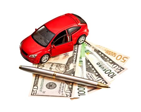 Car, pen and money. Concept for buying, renting, insurance, fuel, service and repair costs photo