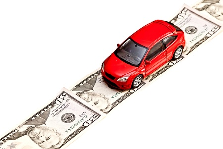 Toy car on the money road, isolated on white  Rent, buy, repair or insurance car concept photo