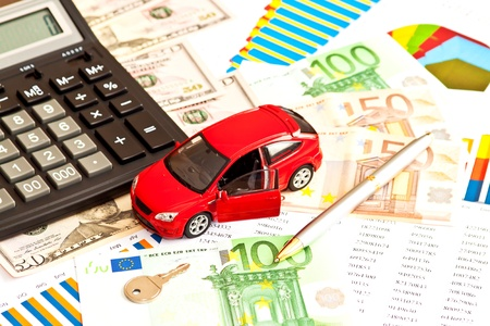 Toy car, money and other business staff Stock Photo