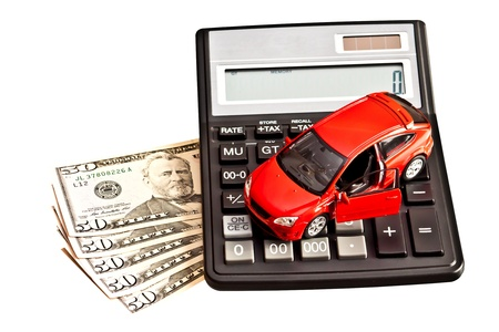 Toy car, calculator and money over white  Rent, buy or insurance car concept Stock Photo