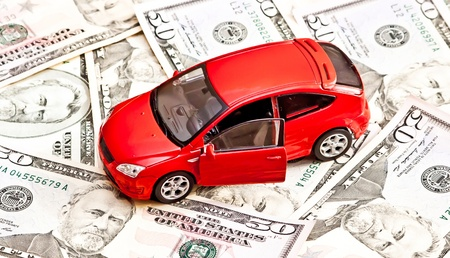 Car and money  Concept for buying, renting, insurance, fuel, service and repair costs photo