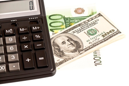 upvaluation: Business picture  money and calculator over white