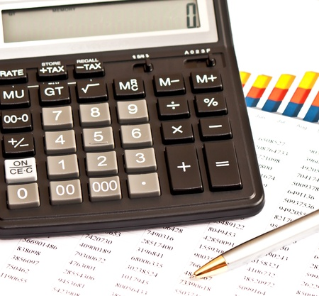Business picture: calculator, financial graphs, pen photo