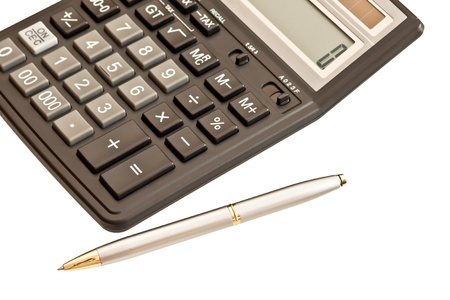 Business picture: calculator and pen isolated on white background photo