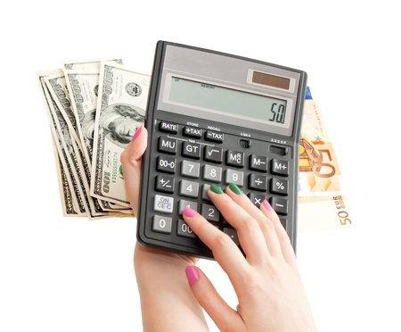 Calculator in businesswoman photo