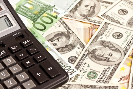 Business picture  money and calculator over white