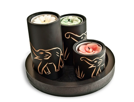 Candles with carved elephants on them - souvenir from Asia or Africa photo