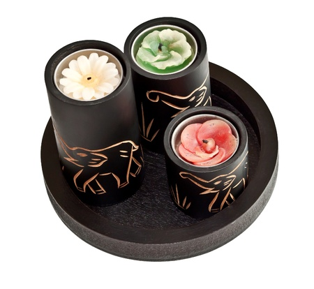 Candles with carved elephants on them Stock Photo
