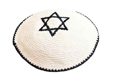 Traditional jewish headwear with embroidered star of David photo