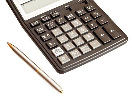 Business picture: calculator and pen isolated on white background