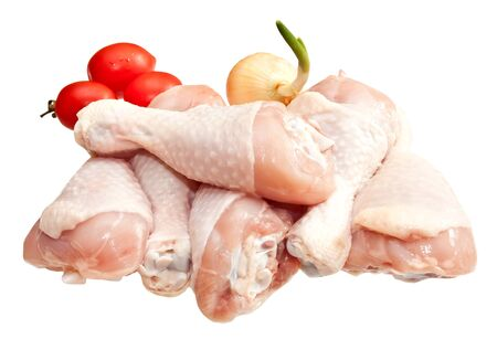 Raw chicken legs with vegetables, isolated on white background  Stock Photo