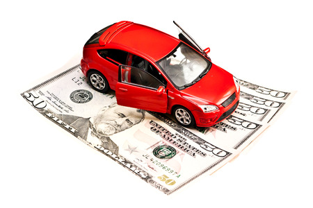 Toy car and money over white  Rent, buy or insurance car concept Stock Photo