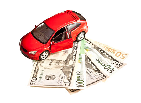 Toy car and money over white. Rent, buy or insurance car concept Stock Photo