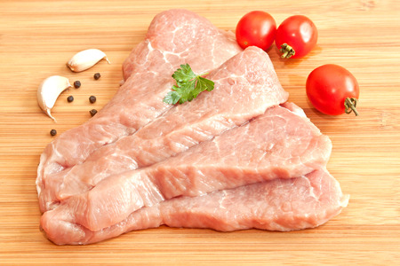 Raw pork with spices and vegetables photo