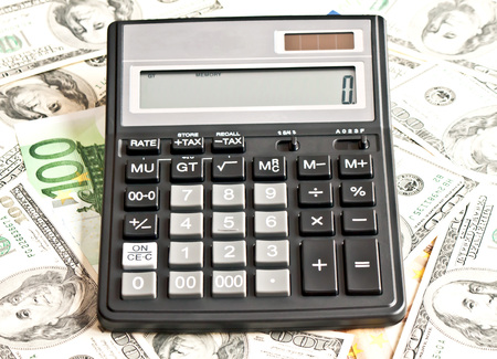 Business picture: money and calculator over white Stock Photo